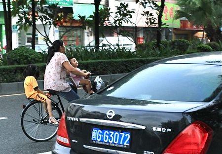 Mom with Babies on Bike